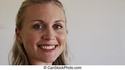 Female teacher smiling in the class - Portrait close up of a...