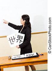 female teacher teaching chinese