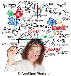 female teacher writing various high school maths and science formula