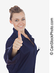 Female technician gesturing thumbs up