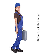 Female technician holding toolkit