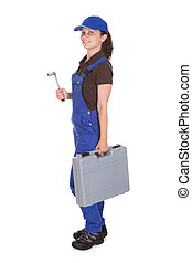 Female technician holding toolkit