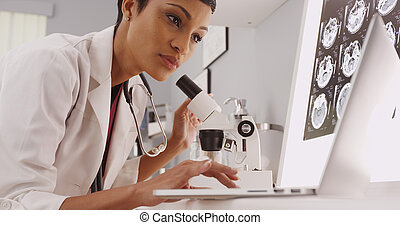 Female technician looking in a microscope