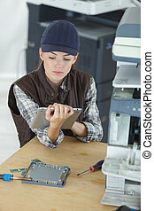 female technician using tablet computer