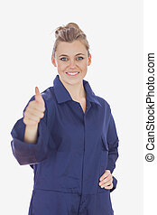 Female technician with hand on waist showing thumbs up sign