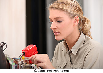 female technician working on an electronic circuit