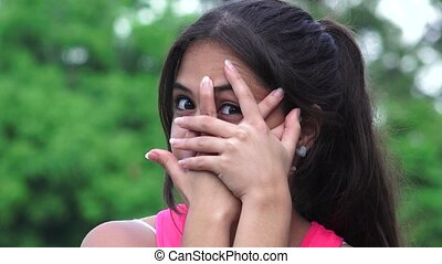 Female Teen Eyes Hands Covering Face