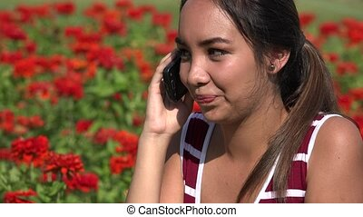Female Teen Listening On Phone Call