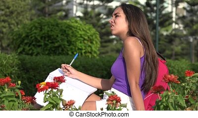 Female Teen Student Studying And Thinking