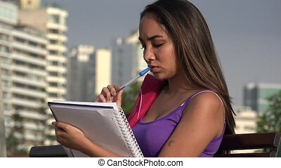 Female Teen Student Studying