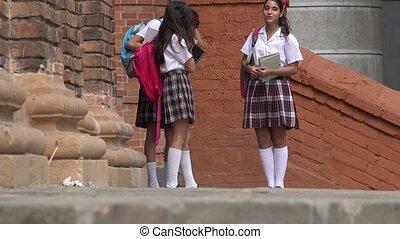 Female Teen Students Walking
