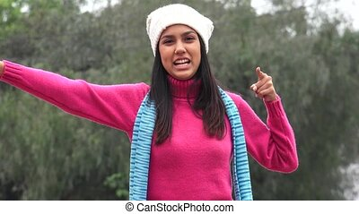 Female Teen Talking Wearing Sweater In Cold