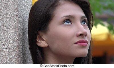 Female Teen Wondering Or Daydreaming