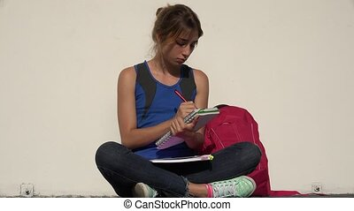 Female Teenage Student Writing