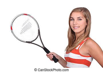 Female teenager holding tennis racket