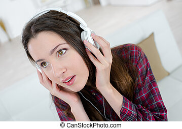 female teenager listening to the music