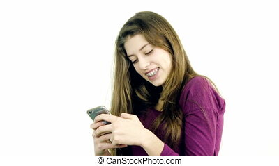 Female teenager playing with phone