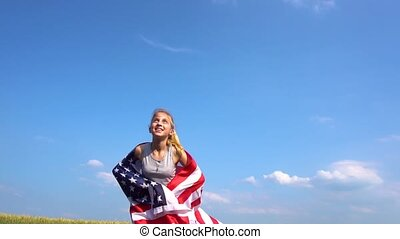 Female teenager throws USA flag in the air - Female teen...
