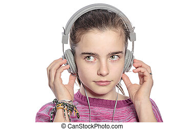 female teenager with headphones hearing music, isolated on white.
