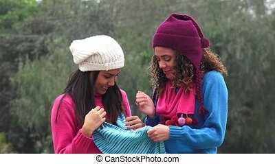 Female Teens Having Fun Wearing Sweaters Cold Weather