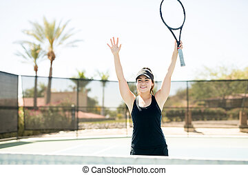 Female tennis player celebrating victory