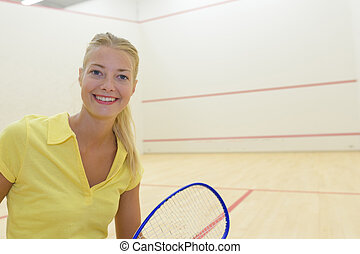 female tennis player equipped in professional sport gear