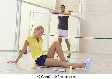 female tennis player fallen on the court