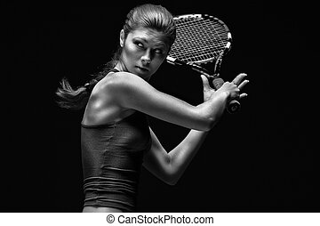 Female tennis player holding racket behind head, isolated on...