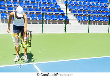 Female tennis player practicing service