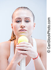Female tennis player with ball