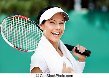 Female tennis player with towel on her shoulders. Active...