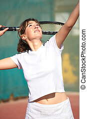 Female Tennis Players - Young woman playing tennis in the...