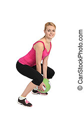 Female throwing medicine ball exercise phase 1 of 2