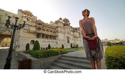Female tourist at Udaipur Palace - Female tourist at City...