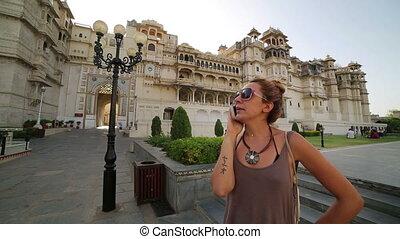Female tourist at Udaipur Palace - Female tourist at Udaipur...