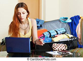 Female tourist buying tickets online