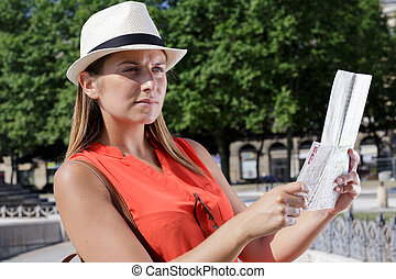 female tourist checking the map