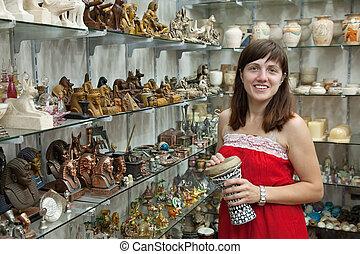 tourist chooses souvenir in egyptian shop - Female tourist...