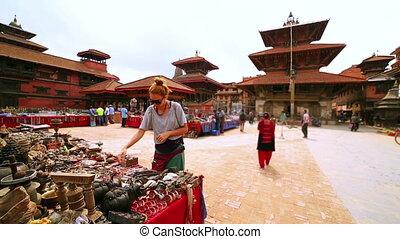 Female tourist choosing souvenir at Patan Durbar Square,...
