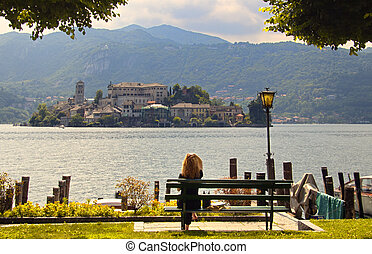 Female tourist looking out over Lake Como from Ballagio, Italy