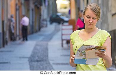 Female tourist lost in the city center.