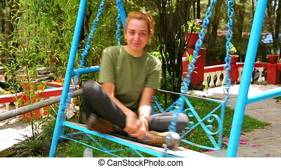 Female tourist playing on swing at Nagarkot, Kathmandu, Nepal