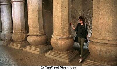 Female tourist visiting Hindu temple - Female tourist...