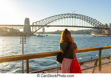 Female tourist with backpack bag taking photos