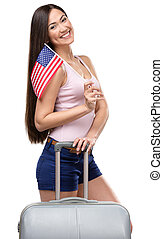 Female tourist with travel suitcase and USA flag -...