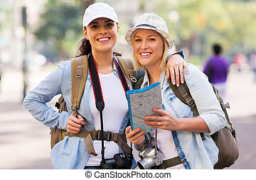 female tourists looking at the camera