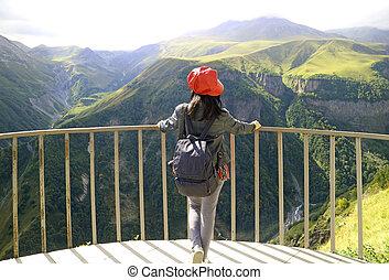 Female Traveler Admiring the View of Devil's Valley from Russia-Georgia Friendship Monument in Gudauri Town, Georgia