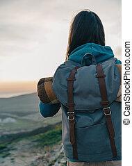 Female traveler with backpack