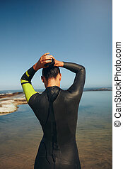 Female triathlon athlete getting ready for the competition