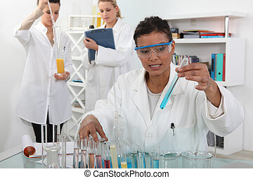 female trio in lab with test-tubes